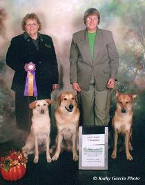 Electra's Grand Champion picture with  her son, NBOB GR CH 'PR' Hurricane Janecek and granddaughter, NBOB  GR CH 'PR' Mystic's Hurricane Sydney sitting to Electra's right.  Also  standing in the picture are the  Honorable Beth Snedegar, who awarded Electra her 5th point; and Joyce  A. Maley, breeder/owner/handler of Electra.
